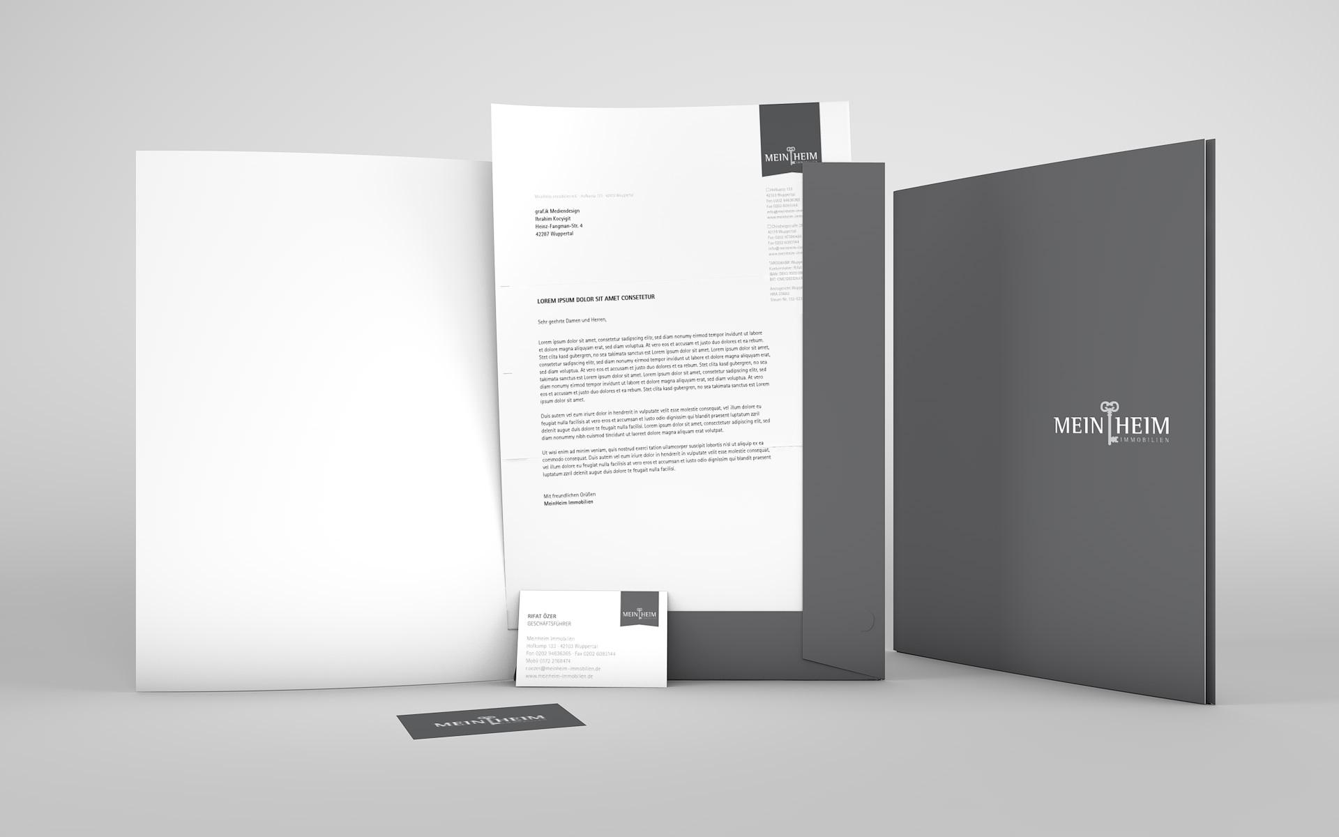 Präsentationsmappe, Briefbogen und Visitenkarte aus dem Corporate Design für MeinHeim Immobilien